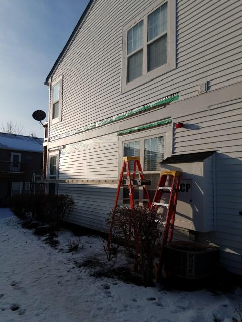 Naperville, IL - Our Installer removed the existing damaged siding and install a new piece along the sidewall.