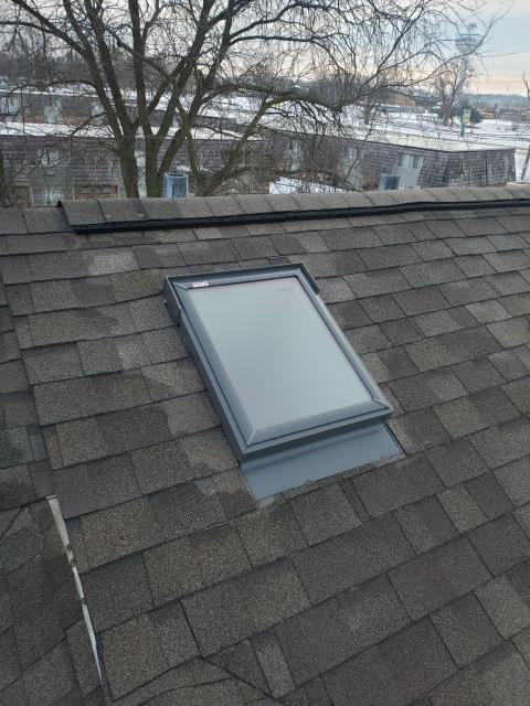 North Aurora, IL - We were called to inspect a leaking skylight and while our roofer was onsite he recommended to have this skylight replaced due to improper flashing.