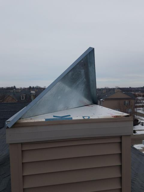Grayslake, IL - Heavy winds caused damage to the top of the chimney flashing. Our installer removed and replaced the flashing with a new one.
