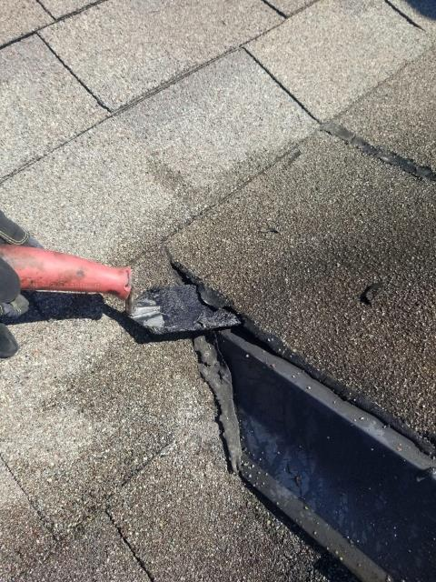 Naperville, IL - Our installer fixed an open seam that was found during a roof inspection.