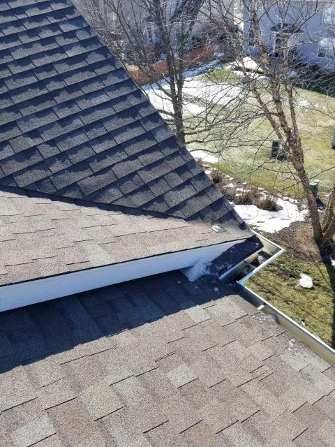 North Aurora, IL - Our roofer removed snow and ice from the gutter edge to prevent water damage in the home.