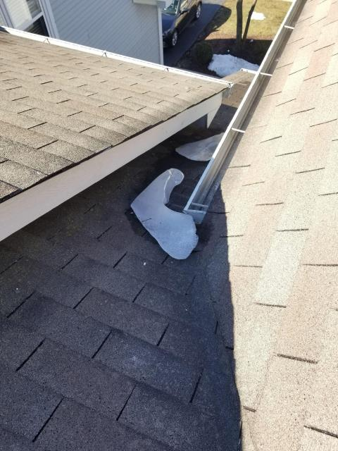 Naperville, IL - During the roof repair, our roofing contractor removed the snow and ice from the gutter system.