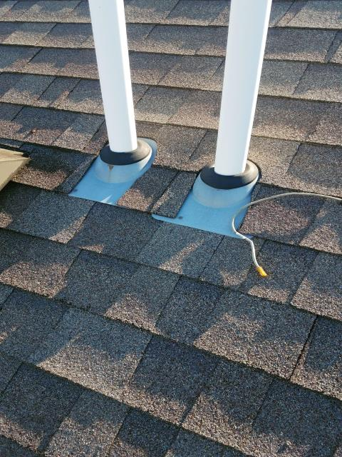 Huntley, IL - Our roofer removed and replaced the existing rubber flashings around both vents.