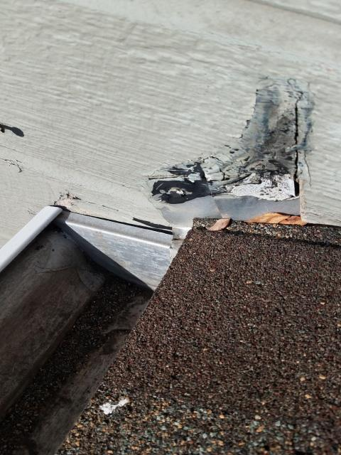 Northbrook, IL - The roof repair team removed the siding along the wall and re-installed roof to wall flashing.