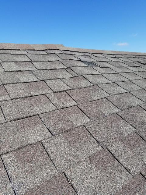 Hanover Park, IL - Our service team replaced the missing shingles on the front section of the building.