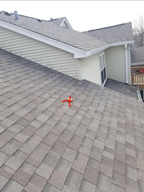 North Aurora, IL - Roofing professional removed and replaced damaged shingles along the front of the home.