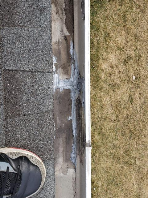 Naperville, IL - During the roof inspection, an open seam was found and re-sealed along the gutter edge.