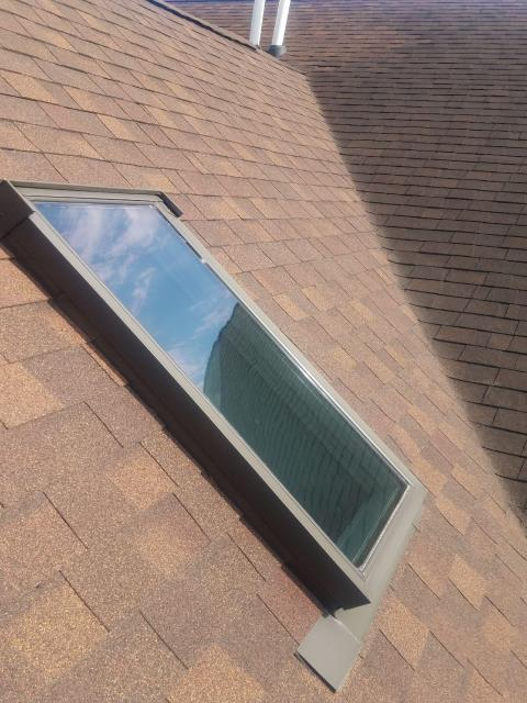 Wheaton, IL - The roofing installer re-sealed the flashing around the skylight.