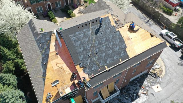 Naperville, IL - Professional roofing crews are busy installing a new Owens Corning Roof System.