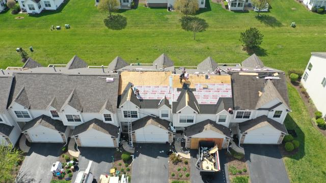 Shorewood, IL - The professional roofing crew is busy installing a new Owens Corning shingle system.