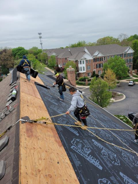 Naperville, IL - Our professional roofing crews are removing the existing roof section and installing a new Owens Corning Oakridge shingle
