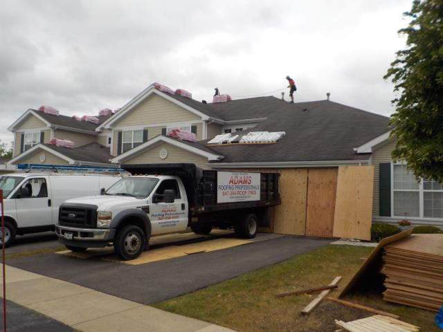 Fox Lake, IL - Roofing crews are working together to complete this project on time.