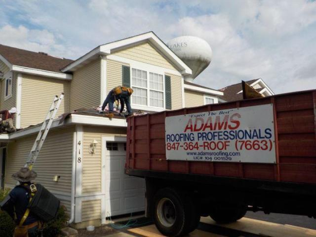 Round Lake Beach, IL - Our professional installer is completing a new Owens Corning Roof system.