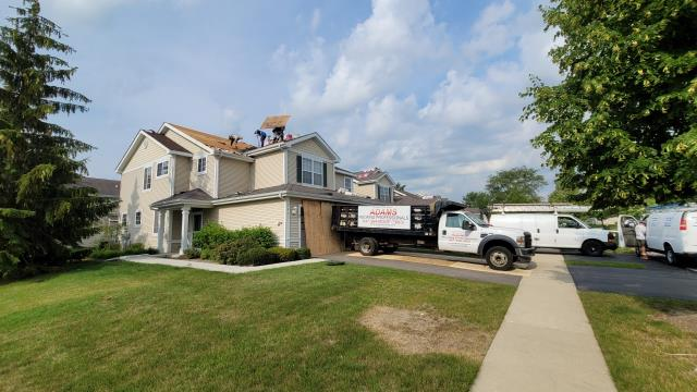 Fox Lake, IL - Hot weather has not slowed down these roofing professionals, our new Owens Corning total protection roof system is making it easy.