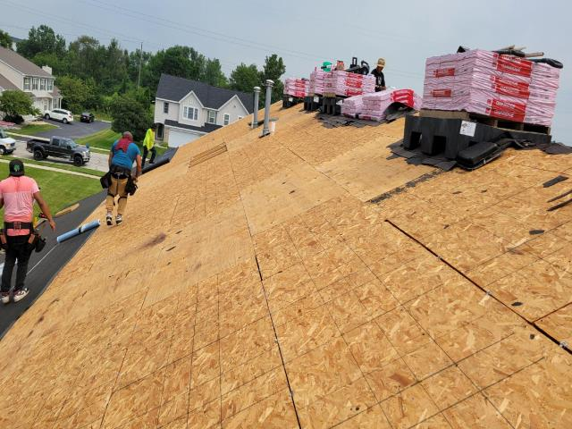 Crest Hill, IL - This professional roofing team is underway installing a new Owens Corning roof system.