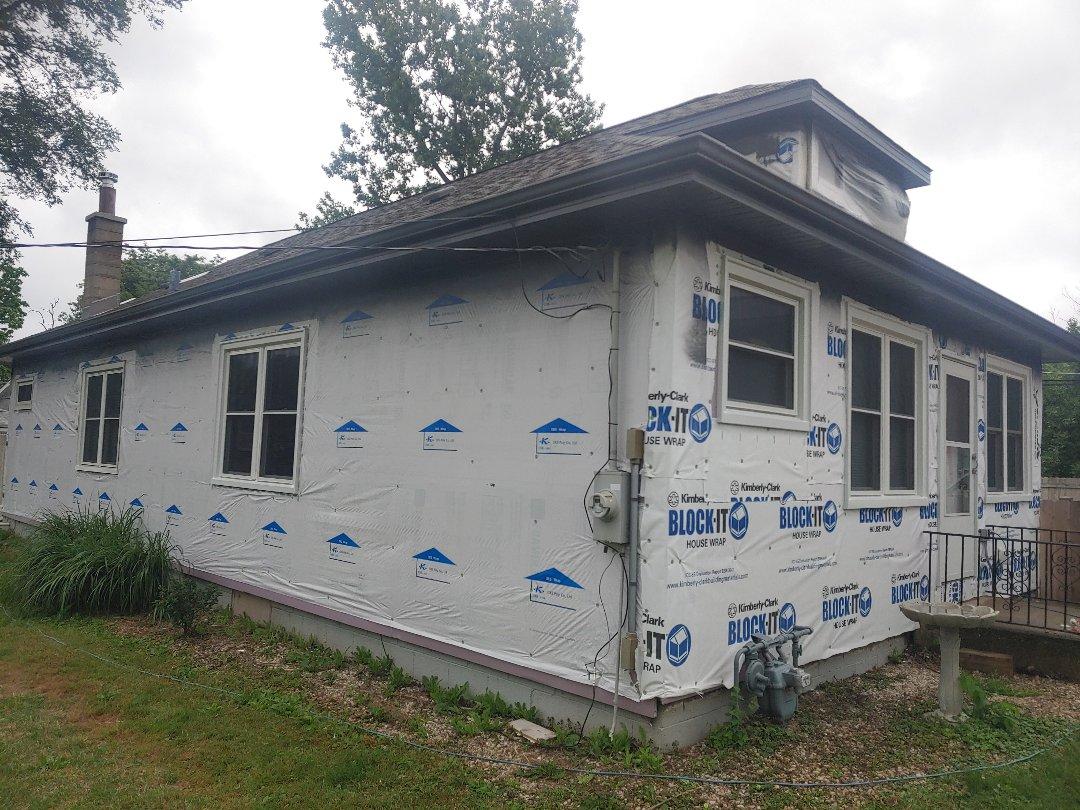 Antioch, IL - New CertainTeed siding Pella window and soffit fascia