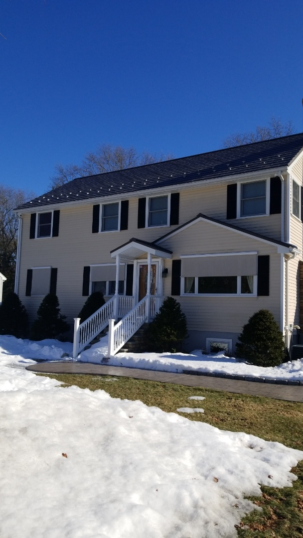 Stow, MA - The Oxford slate aluminum shingle in shake gray. This 2 story colonial has never looked better.
