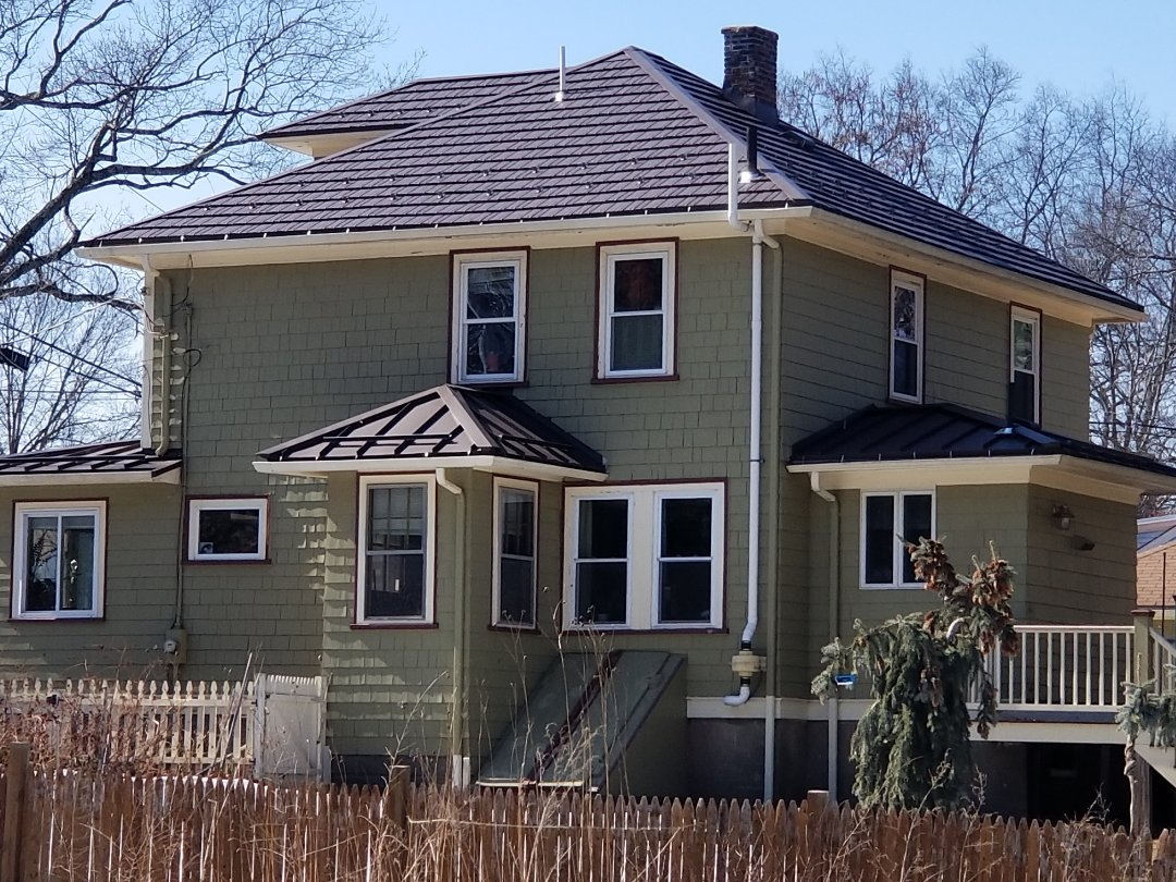 Maynard, MA - Beautiful mustang brown metal shingle Rustic shake with accent roofs in standing seam metal roofing.