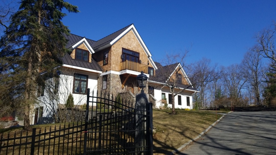 Sudbury, MA - Standing seam aluminum roof in dark bronze. It's not  just a metal roof it's a Classic Metal Roof. The best roof under the sun!
