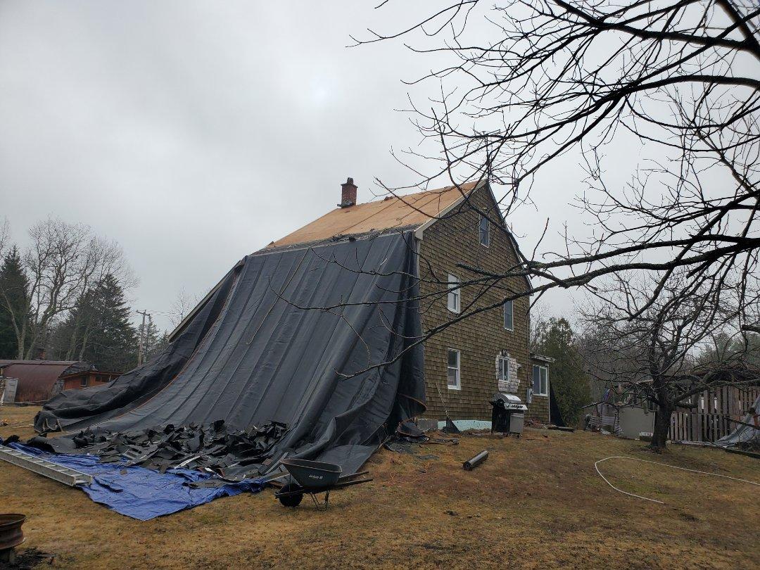 Rutland, MA - Just getting started on aluminum standing seam metal roof in Rutland Mass