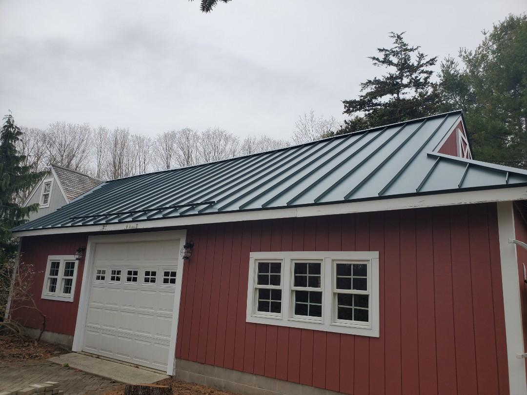 Aluminum metal standing seam roof on garage .