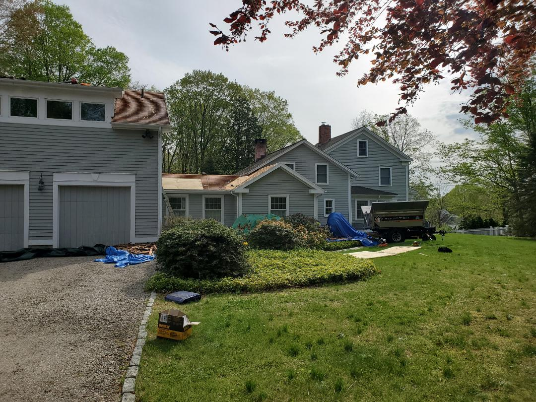 Easton, CT - Tearing off old wooden shingles and installing new aluminum metal standing seam roof