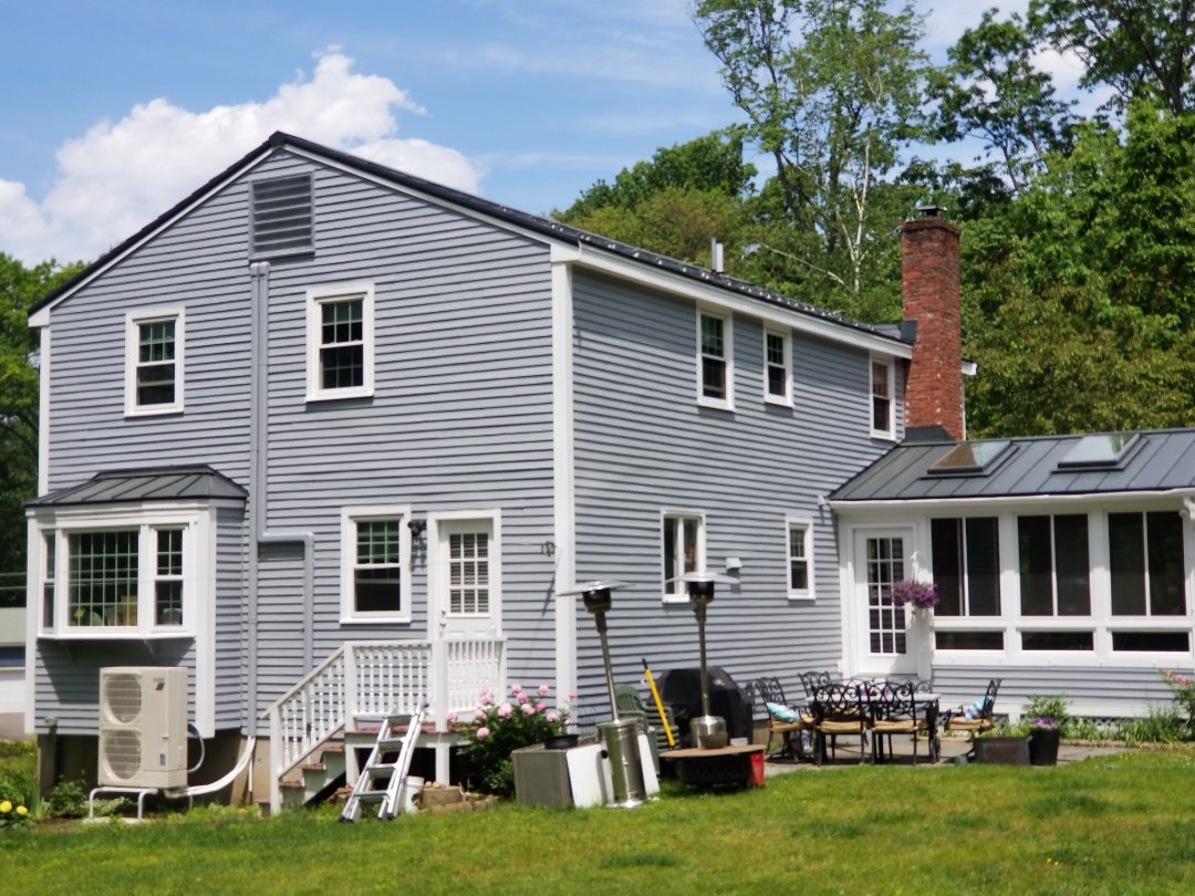 Stow, MA - Aluminum metal slate shingle roof.MCA approved. Standing seam accent roof. Custom paneled bay window.