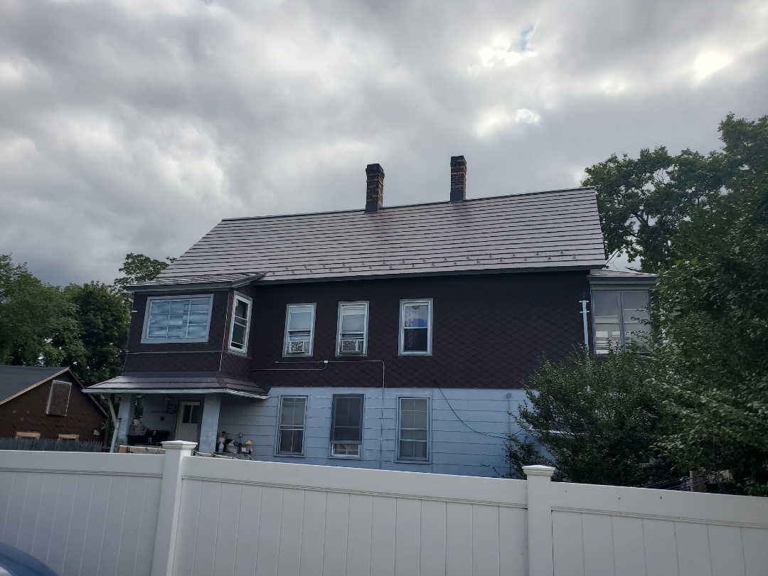 A new aluminum metal shingle roof makes a big difference.