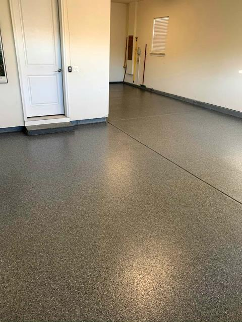 Epoxied garage floors are great for creating a man cave space in your home
