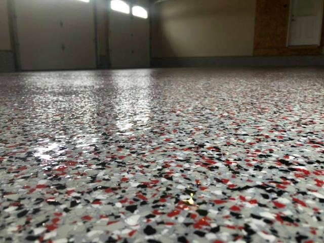 Hamilton, OH - Want a garage floor that reflects your team spirit? We have your covered! We offer Epoxy flake and Graniflex in any color you can imagine!