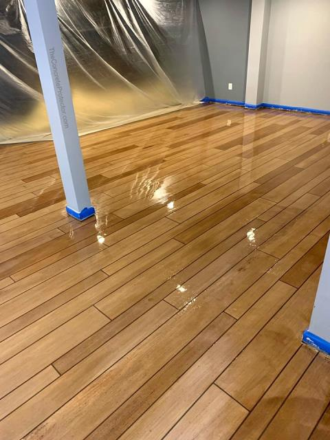 AMAZING wood floor! The quality is very fine! I love looking at it! The coating looks very well done and shiny! Garage Floors Today is very professional and well-mannered and their floors are everything you could ever want! The wood floors they do are indistinguishable from real wood! Its truly amazing!