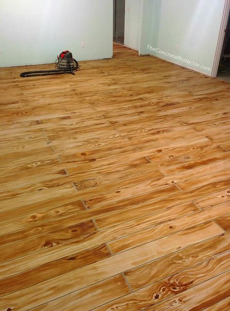 Garage Floors today makes decorative wood floor coatings like none other! If you haven't seen the work that they have done, you have to check it out! The wood will blow your mind! They can make it look so real! But with none of the worry, cost, or hassle that comes with putting down real wood.