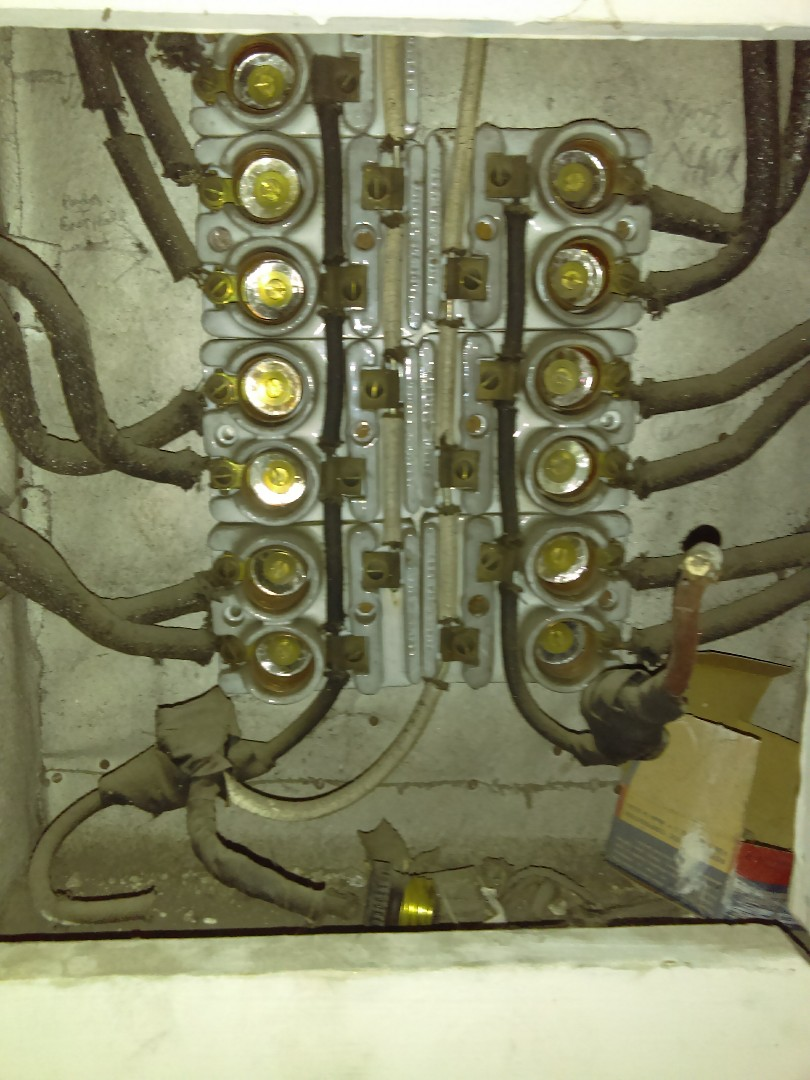 Helping a local church remove an outdated, non-operational, out of code Fuse Panel & Circuitry.