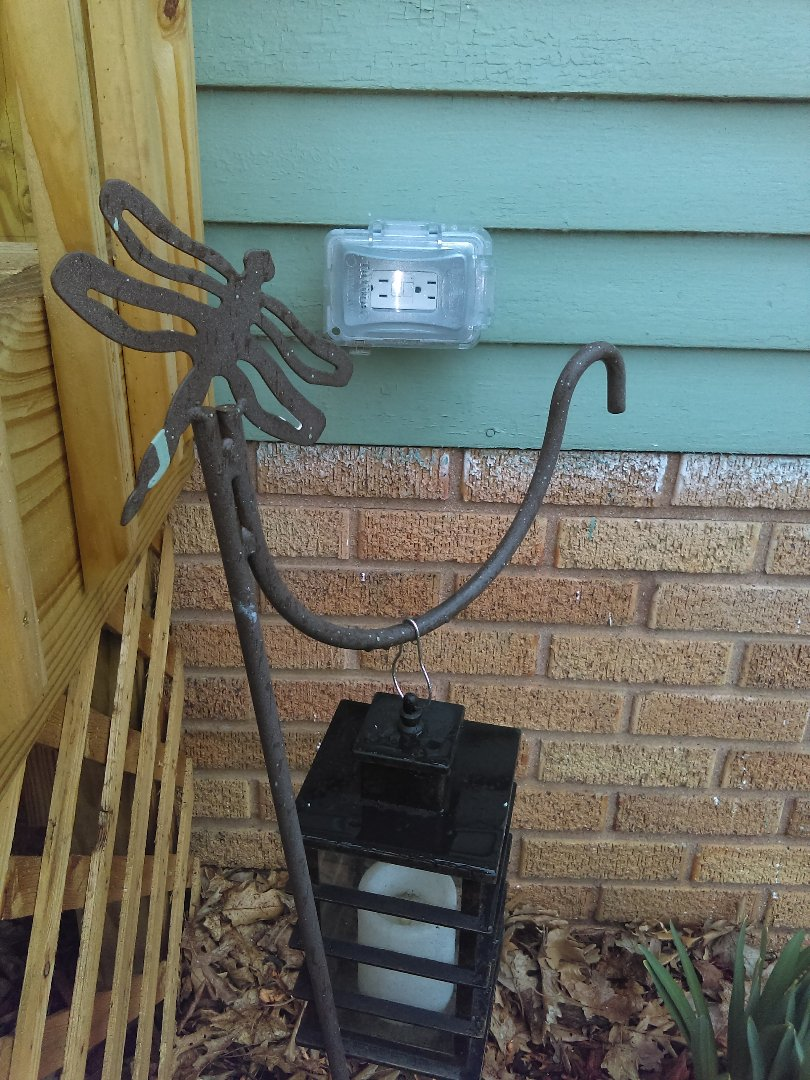 Installing new weather proof outlet on exterior of home.