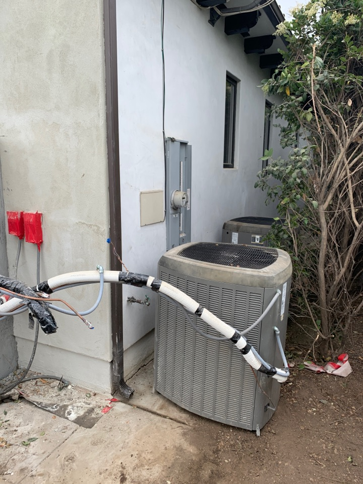 Montebello, CA - Temporarily moved two communicating Lennox condensers XC 21 here in Montebello