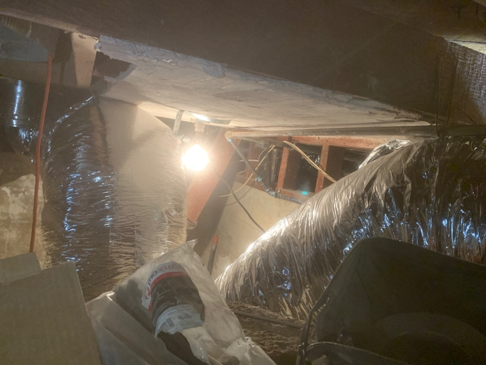 Long Beach, CA - Running ductwork in a tight crawl space in sunny Long Beach.