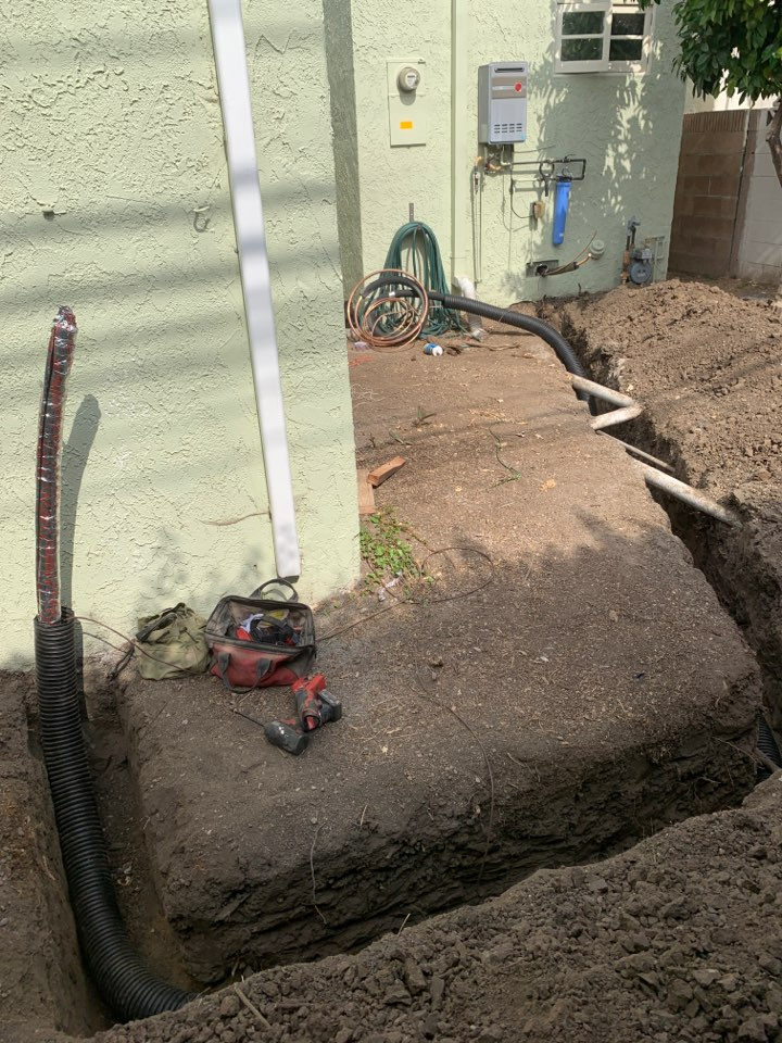 """Long Beach, CA - Running line set in 4"""" corrugated black pipe to a Lennox Elite condensing unit in sunny California Heights"""