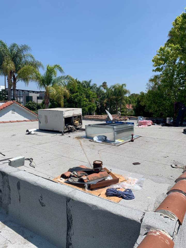 Los Angeles, CA - Installation of a package unit change out and ducting new adjustable curb being installed here in West Hollywood