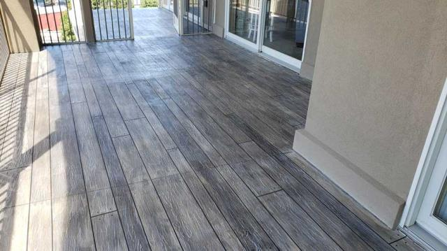 Seattle, WA - Imagine your existing concrete completely transformed into the look of wood flooring! Our Rustic Decorative Concrete Wood can permanently transform the look of any basement, living/family room, patio, or porch!