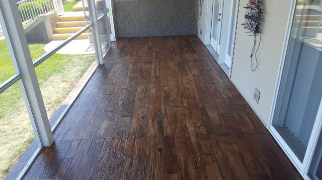 Olympia, WA - Our Rustic Faux Concrete Wood system is a flooring option that will amaze all of your guests . . . textured and stained concrete epoxy floors that look just like wood!