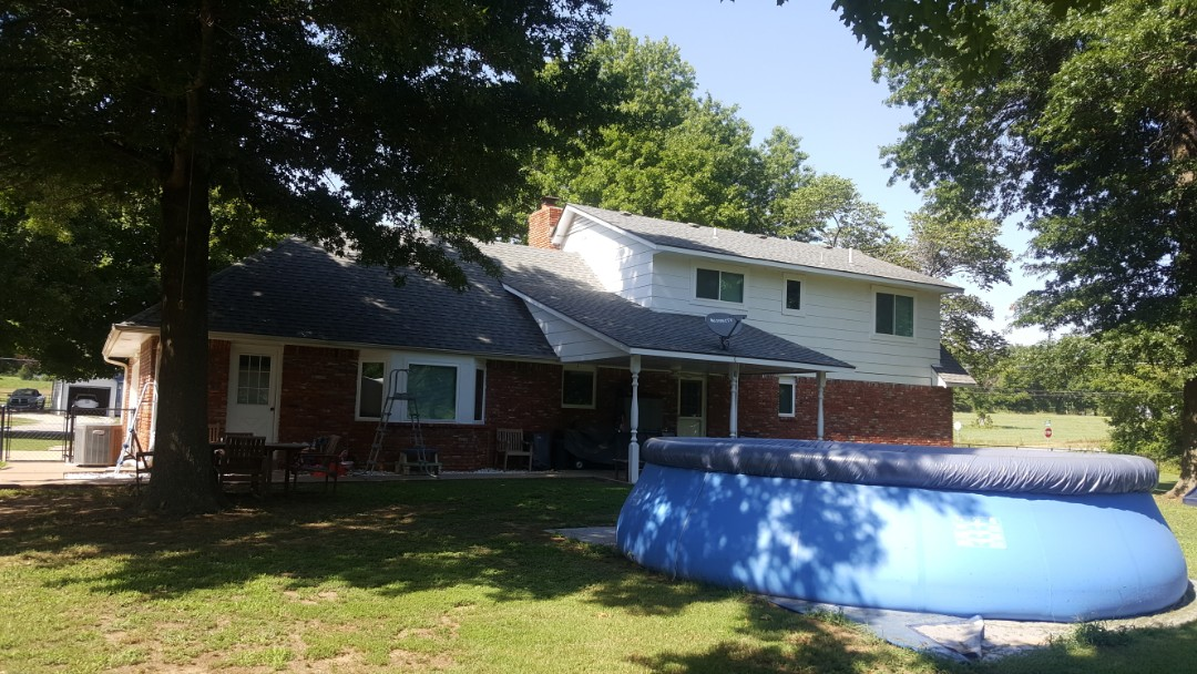 Claremore, OK - Beautiful transformation of the house just by installing new windows and a front door