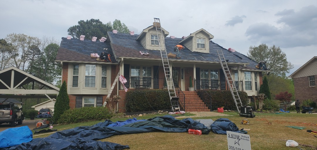 These guys are working hard to get these shingles back on top in 5 Star Condition!