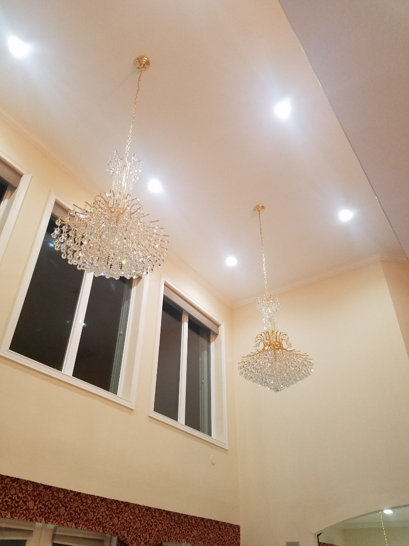 Apollo Beach, FL - Installing Tampa Bay's finest chandeliers! Need a chandelier lift for those high ceilings? Well we did it here. Beautiful choice of chandeliers by the homeowner.