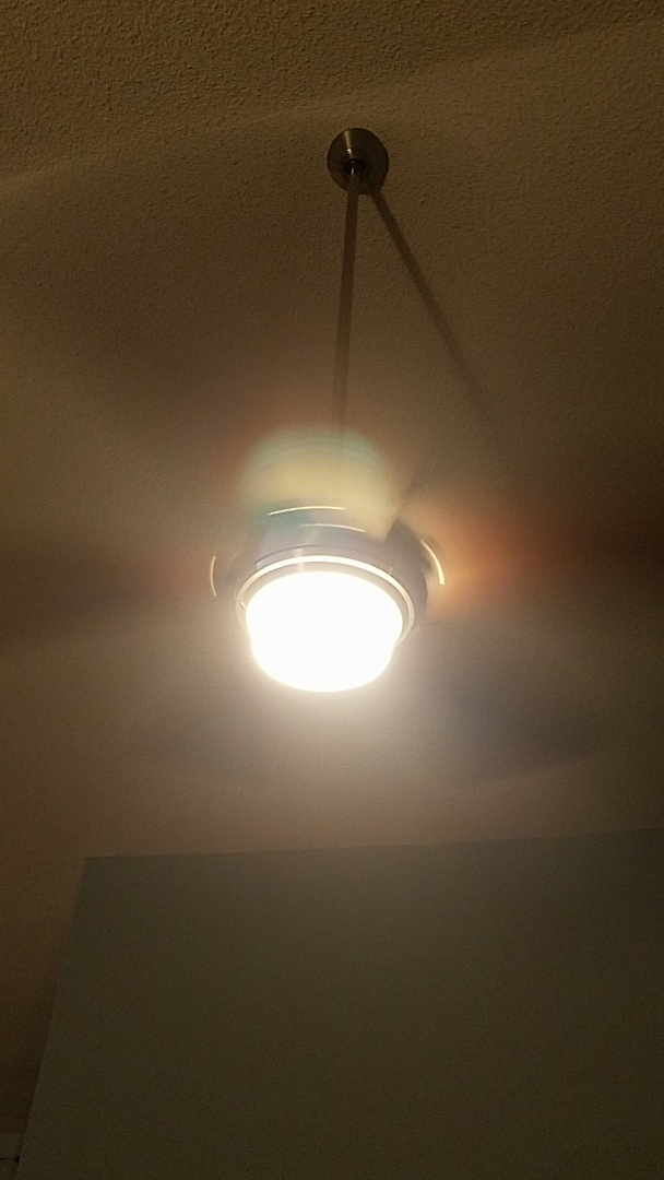 Palm Harbor, FL - Install a ceiling fan in the living room got to beat the heat somehow