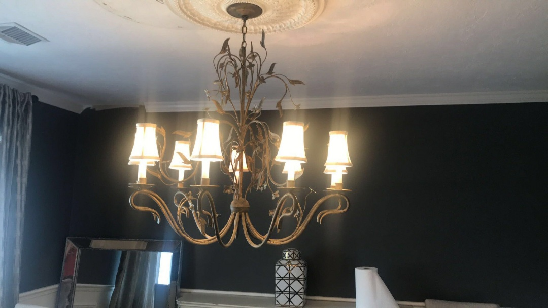 Tampa, FL - Rewired chandelier and moved chandelier to center of room.