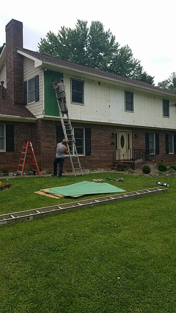 Hendersonville, NC - Starting a James Hardie reside job.  Removed old siding and discovered house has no sheathing!  Installing Zip brand board as sheathing and waterproofing.