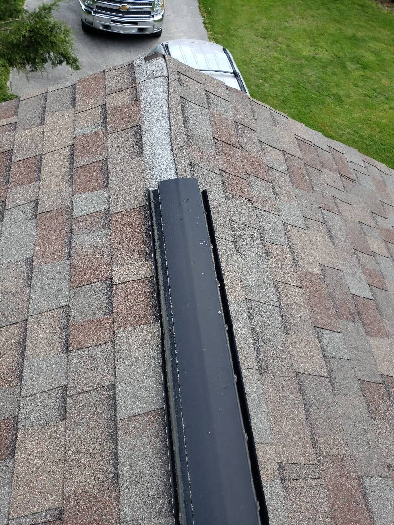 Clinton, TN - Mobley Brothers Roofing repaired a roof leak caused by a broken ridge vent and corrected problems with the roof by installing new step and counter flashing around the chimney. We installed IKO weathered wood shingles.
