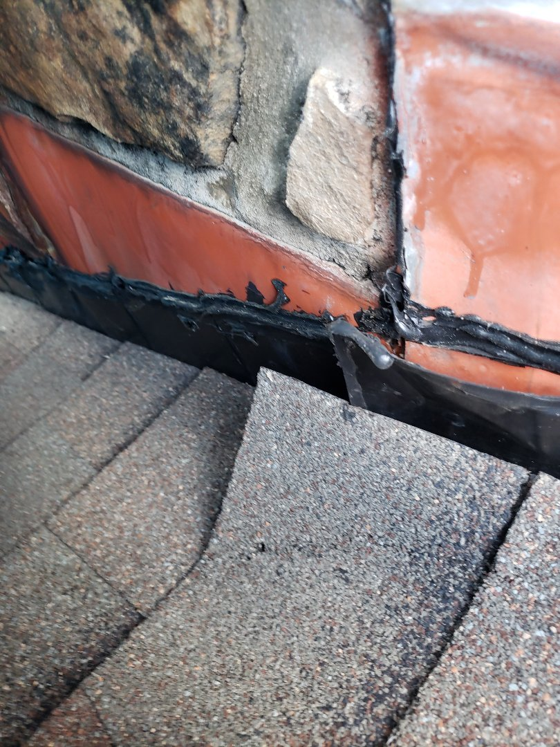 Clinton, TN - As part of Mobley Brothers Roofing and Renovation repairing a roof leak, we removed damaged step flashing and replaced it.