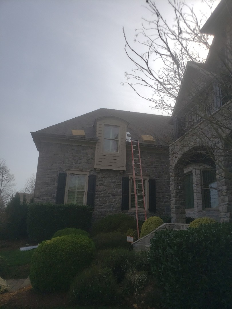 Knoxville, TN -  A house needed a dormer leak repair. Mobley Brothers Roofing used GAF Timberline HD Weathered Wood Shingles, GAF Storm Guard Leak Barrier and step flashing.