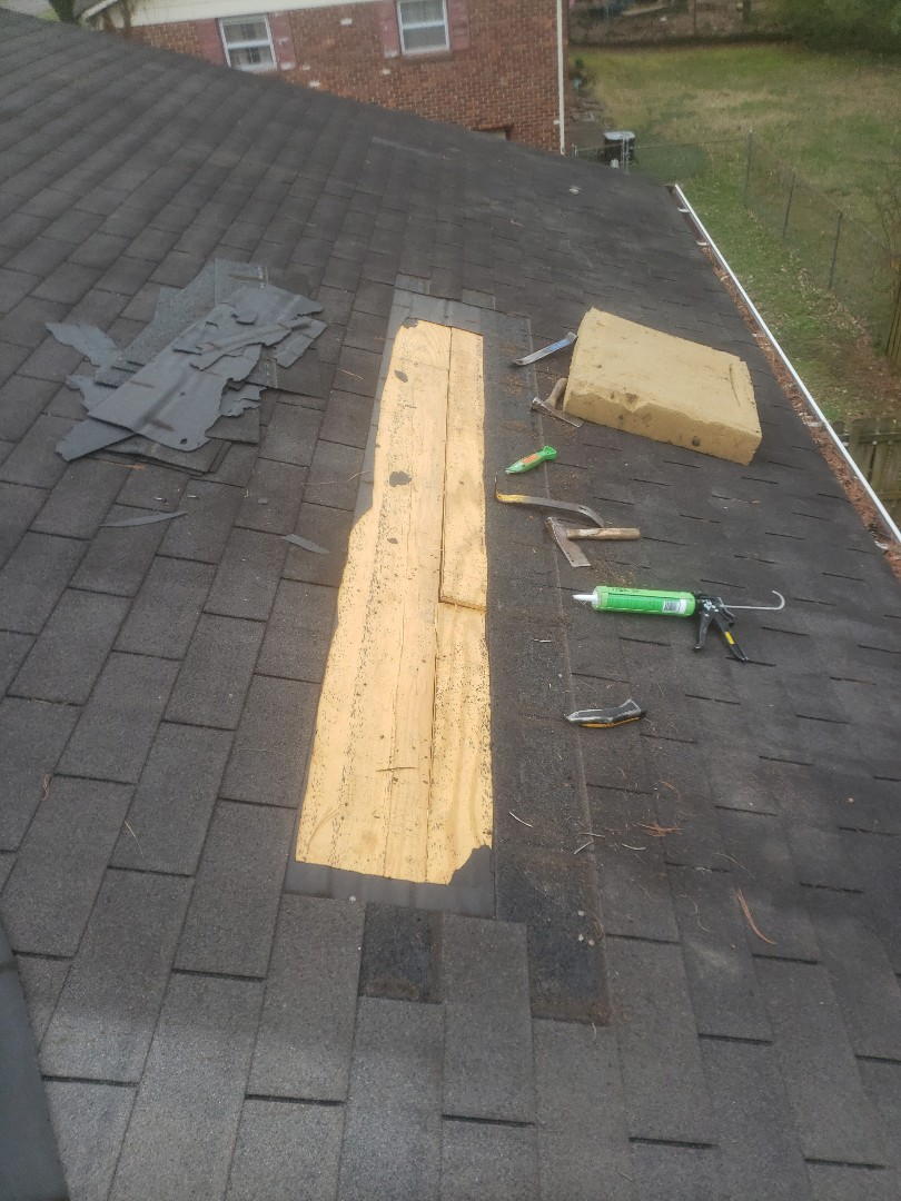 Knoxville, TN - A landlord called us about a roof leak at a rental house. Mobley Brothers Roofing removed the damaged shingles and wood. We installed Certainteed Charcoal Black shingles, GAF Storm Guard Leak Barrier and cleaned out the gutter.